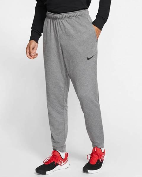 Sivé tepláky Nike